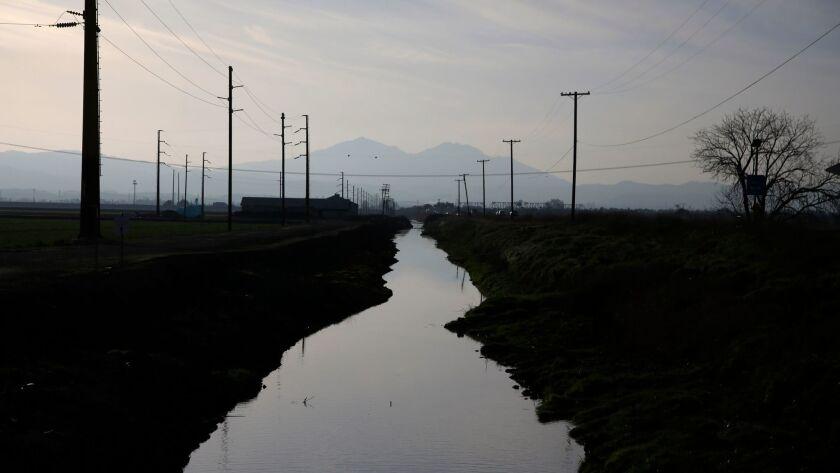 STOCKTON, CA - Feb. 25, 2016: A waterway along Route 4 in the Sacramento-San Joaquin Delta, right ou