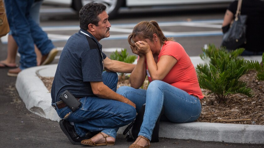People grieve at a hotel near the Orlando Regional Medical Center, where many of the victims were treated.