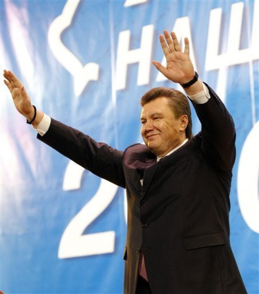 Presidential candidate and head of Regions party Viktor Yanukovich greets his supporters in the town of Yenakiyevo, some 50 km (31 miles) north-west of Donetsk, Ukraine, Tuesday, Feb. 2, 2010. Ukrainian opposition leader Yanukovych and Prime Minister Yulia Tymoshenko will face each other in the sec