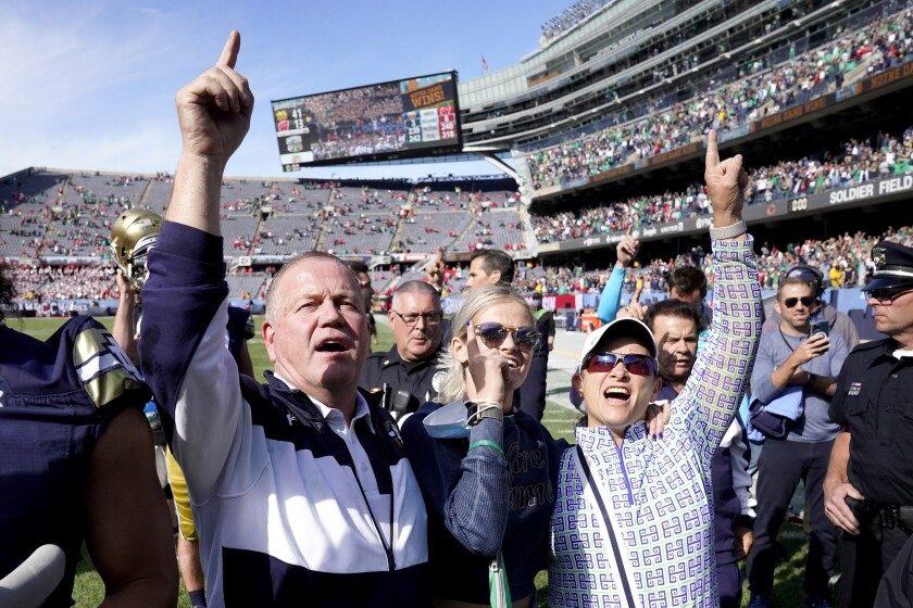 Notre Dame coach Brian Kelly, left, and his family celebrate a 41-13 win over Wisconsin on Sept. 25, 2021, in Chicago.