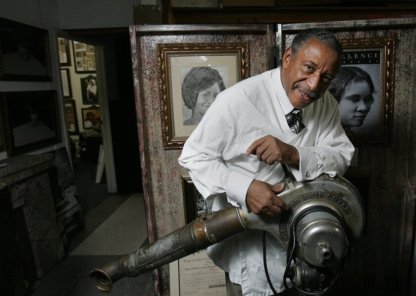 Longtime entrepreneur Willie Morrow has a collection of antique barber tools in his Lemon Grove warehouse, including a vintage hair dryer from the turn of the 20th century. JOHN GASTALDO • U-T