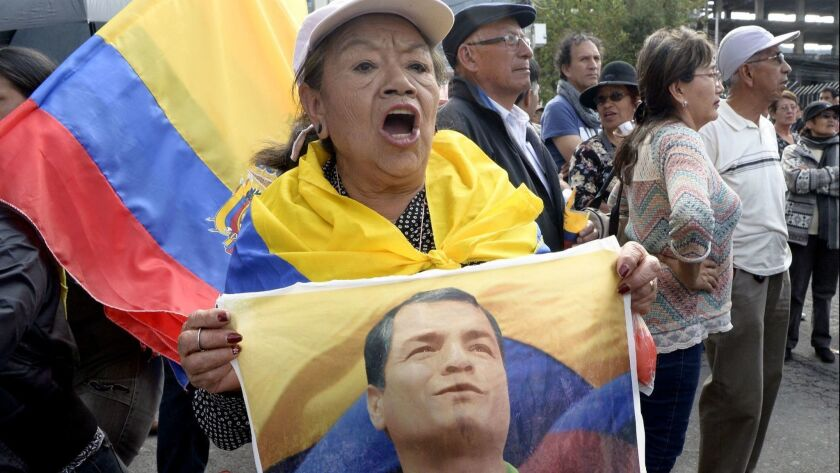 Supporters of former Ecuadorean President Rafael Correa protest outside the National Court of Justice in Quito in June after a judge linked Correa to the kidnapping of an opposition lawmaker.