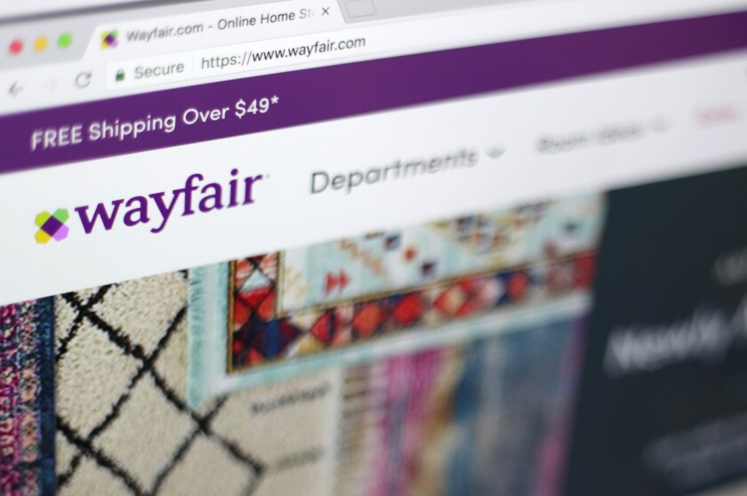 This Tuesday, April 17, 2018, photo shows the Wayfair website on a computer in New York. Wayfair, an online furniture seller, is calling April 25 Way Day, and will offer discounts that it says are comparable to its Black Friday deals.