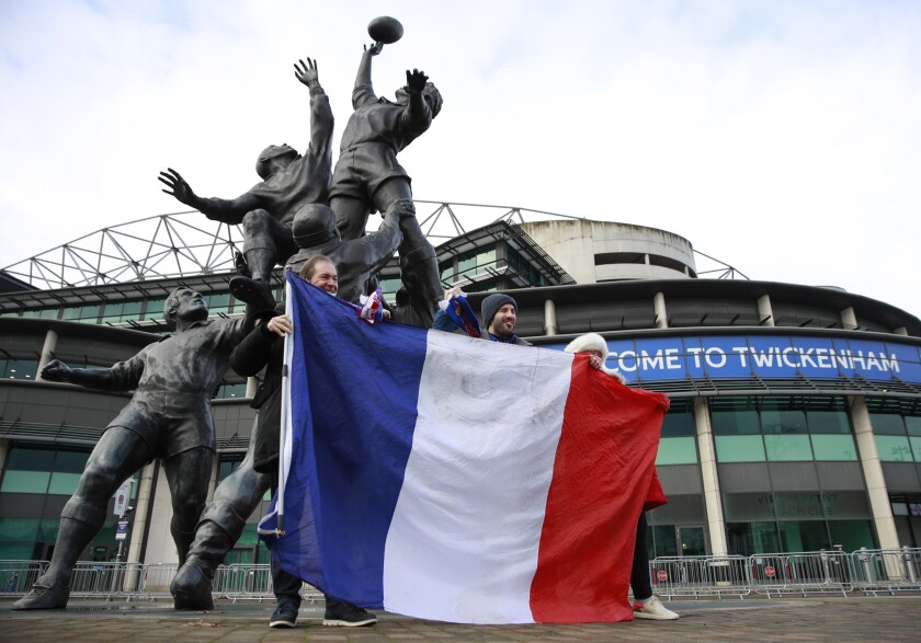 French supporters pose for a photo as they arrive for the Autumn Nations Cup final rugby union international match between England and France at Twickenham stadium in London, Sunday, Dec. 6, 2020. Two thousand spectators, including 400 NHS workers who have received free tickets, will be in attendance as COVID-19 restrictions are eased after the latest lockdown. (AP Photo/Ian Walton)