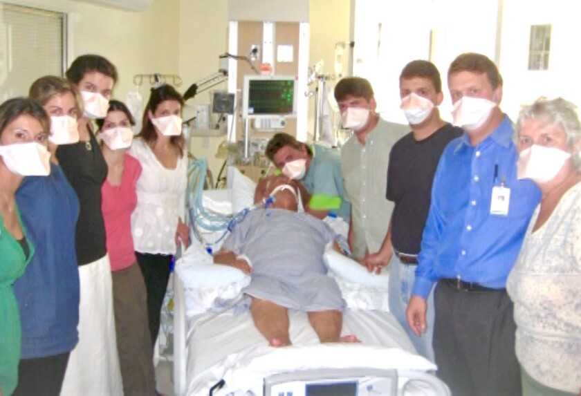 Dr. Nick Yphantides, San Diego County's chief medical officer, is shown here with other members of his family in a local hospital. He is cradling the head of his dad, George Yphantides, 70, who died during the H1N1 swine flu pandemic in 2009. Yphantides posted this photo on his Facebook page.