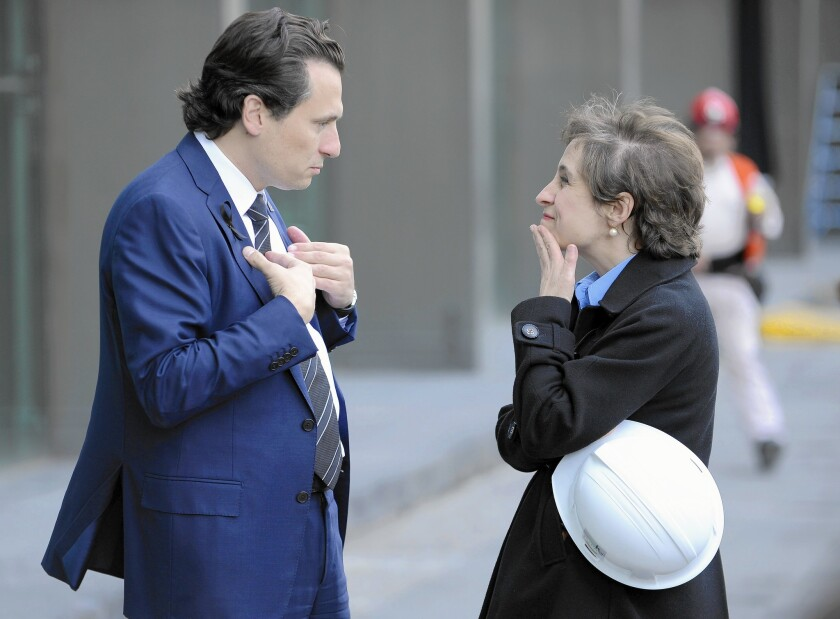 Mexican journalist Carmen Aristegui talks to Pemex Chief Executive Emilio Lozoya in 2013. She is in conflict with her bosses at a radio station.