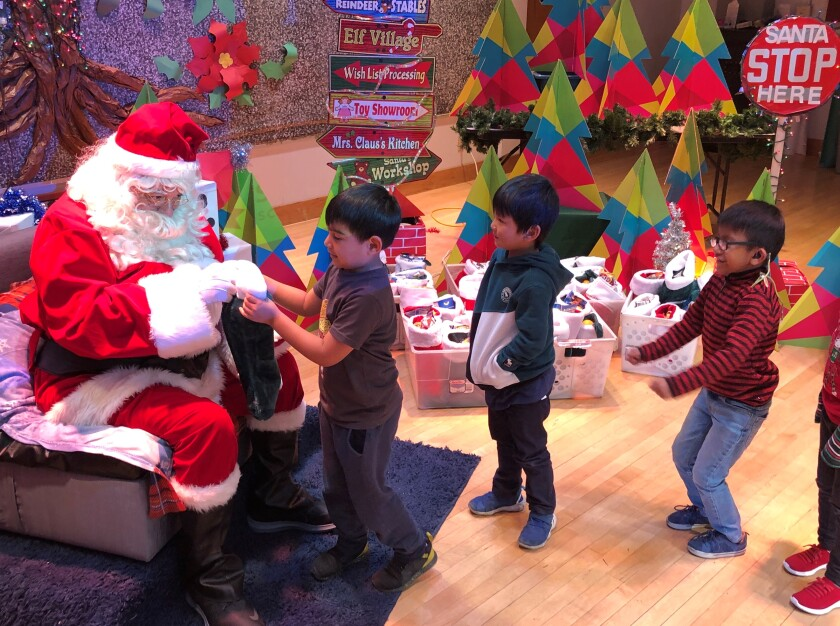 Santa handed out gifts to students at Ross Elementary School.