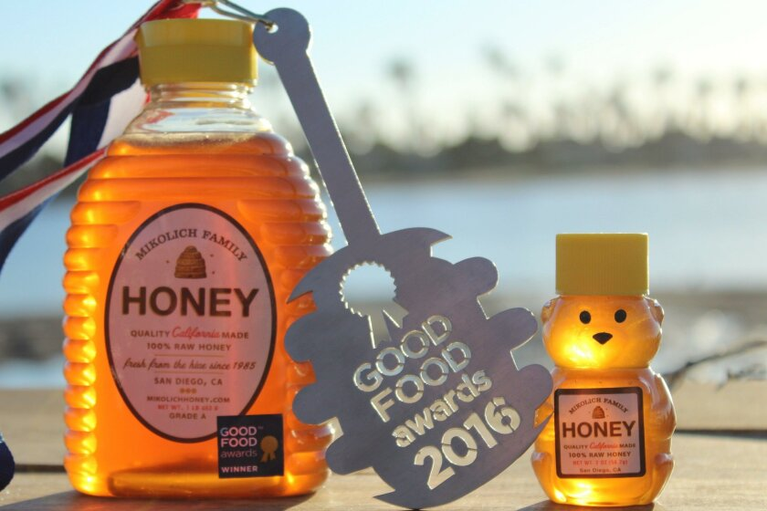 Squeeze bottles of Mikolich Family Honey.