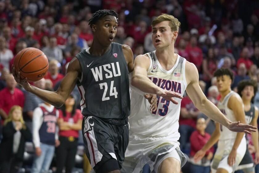 Washington State guard Noah Williams (24) drives past Arizona forward Stone Gettings in the first half of an NCAA college basketball game Thursday, March 5, 2020, in Tucson, Ariz. (AP Photo/Rick Scuteri)