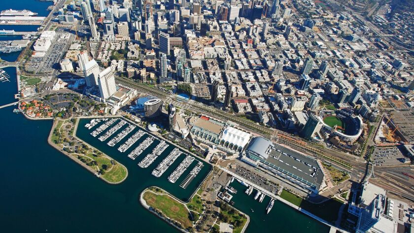 In this 2015 file photo, the San Diego Convention Center is bracketed by the Marriott, Manchester Grand Hyatt and Bayfront Hilton.