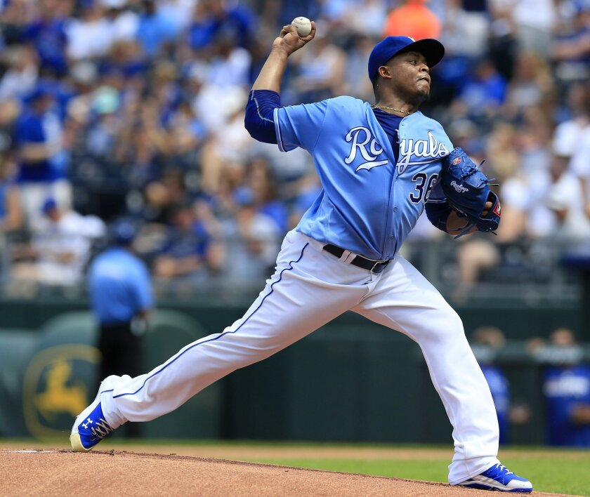 Kansas City Royals starting pitcher Edinson Volquez delivers to a Seattle Mariners batter during the first inning of a baseball game at Kauffman Stadium in Kansas City, Mo., Saturday, July 9, 2016. (AP Photo/Orlin Wagner)