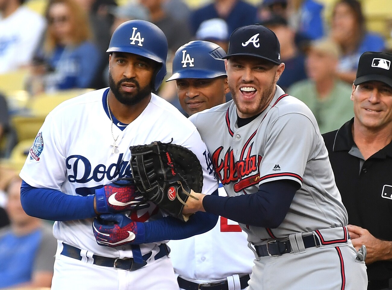 LOS ANGELES, CA - JUNE 08: Matt Kemp #27 of the Los Angeles Dodgers and Freddie Freeman #5 of the Atlanta Braves share a laugh after Kemp singled in the first inning at Dodger Stadium on June 8, 2018 in Los Angeles, California. (Photo by Jayne Kamin-Oncea/Getty Images) ** OUTS - ELSENT, FPG, CM - OUTS * NM, PH, VA if sourced by CT, LA or MoD **