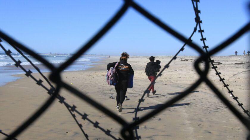 SAN DIEGO, CA- TIJUANA, MX 03-14-2019 U.S.-MEXICO BORDER WALL HONDURAN MIGRANTS BREAK THROUGH BORD