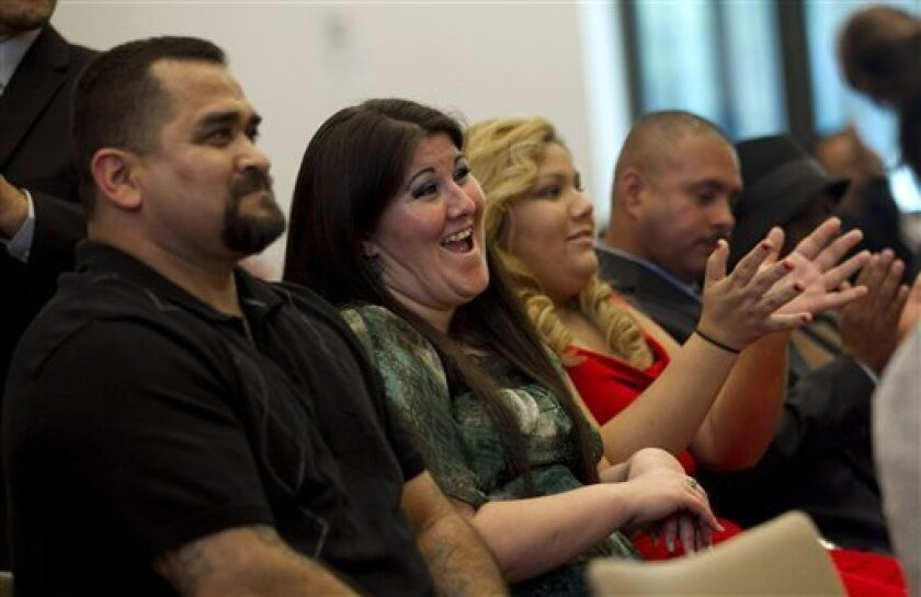 "Melissa Pirraglio, second from left, applauds during the graduation ceremony of the Los Angeles Violence Intervention Training Academy (LAVITA) in Los Angeles, Tuesday, Dec. 20, 2011. Pirraglio spent many of her 11 years of gang life in drug-addled despair seeking a way out. ""There's an inkling in"
