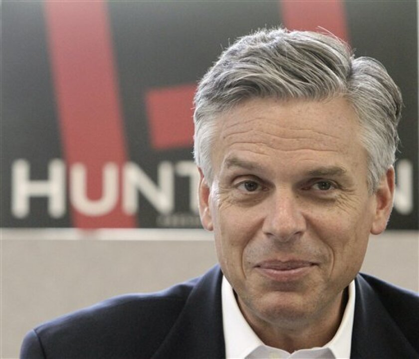Republican presidential candidate, former Utah Gov. Jon Huntsman listens to questions during a meeting with area business leaders and lawyers during a campaign stop in Concord, N.H., Thursday, Sept. 1, 2011. (AP Photo/Jim Cole)