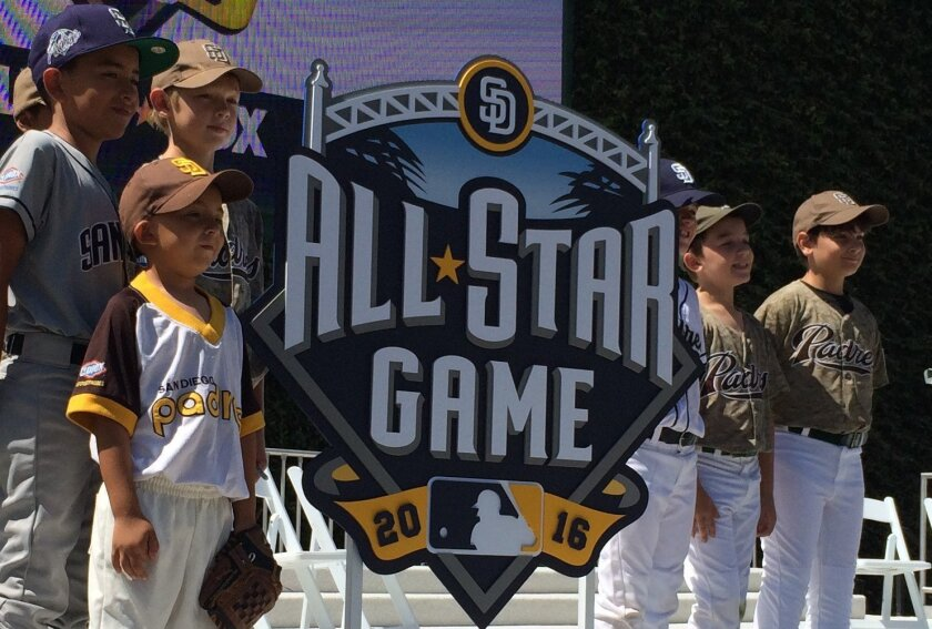Local Little Leaguers stand with the Padres' 2016 All-Star Game logo at the official unveiling Friday morning at Petco Park.
