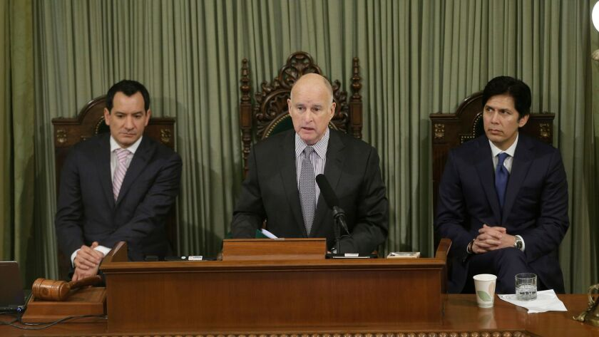Gov. Jerry Brown, flanked by Assembly Speaker Anthony Rendon (left) and Senate President Pro Tem Kevin de León, delivers his final State of the State address in Sacramento on Jan. 24.