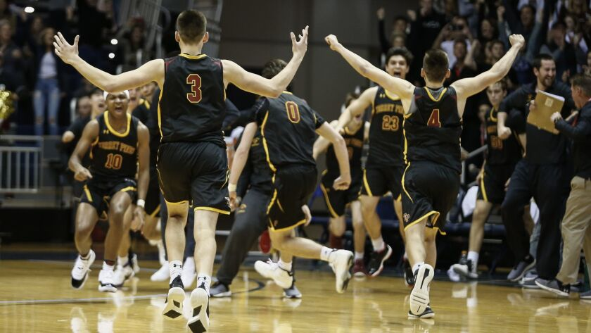 Torrey Pines players celebrate their Open Division championship Saturday night at RIMAC Arena.