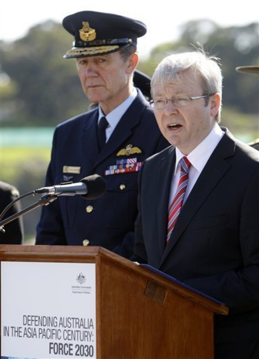 """Prime Minister Kevin Rudd, right, announces the government's defense white paper as Chief of the Defense Force Angus Houston, left, looks on, aboard HMAS Stuart at Garden Island naval base in Sydney, Australia, Saturday, May 2, 2009. Its 140-page white paper - Defending Australia in the Asia Pacific Century: Force 2030, released on Saturday - outlines defense and strategic planning and signals what the government calls a major new direction aimed at building a """"heavier"""" naval, air combat and logistics capability in the Asia Pacific. (AP Photo/Rick Rycroft)"""