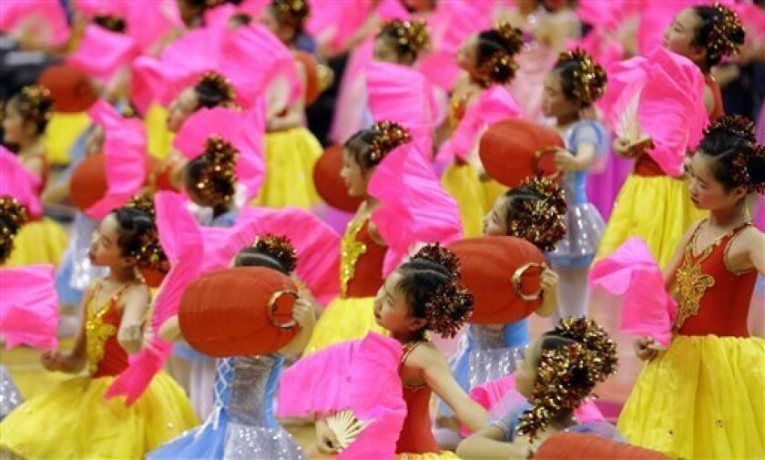 Dancers from the Jin Ling Dance School perform in celebration of the Chinese New Year before an NBA basketball between the Washington Wizards and the Brooklyn Nets, Friday, Feb. 8, 2013, in Washington. (AP Photo/Alex Brandon)