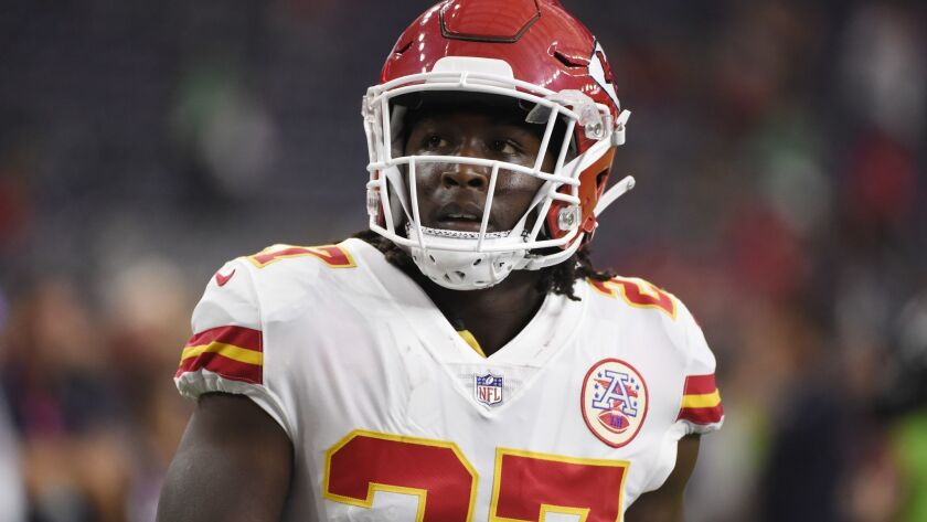 FILE - In this Oct. 8, 2017, file photo, Kansas City Chiefs running back Kareem Hunt warms up for th