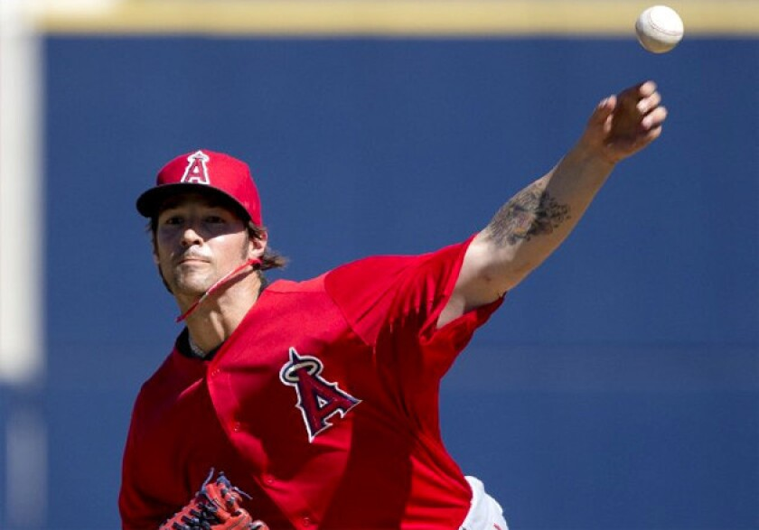 C.J. Wilson gave up two runs and four hits in 1 2/3 innings Saturday.