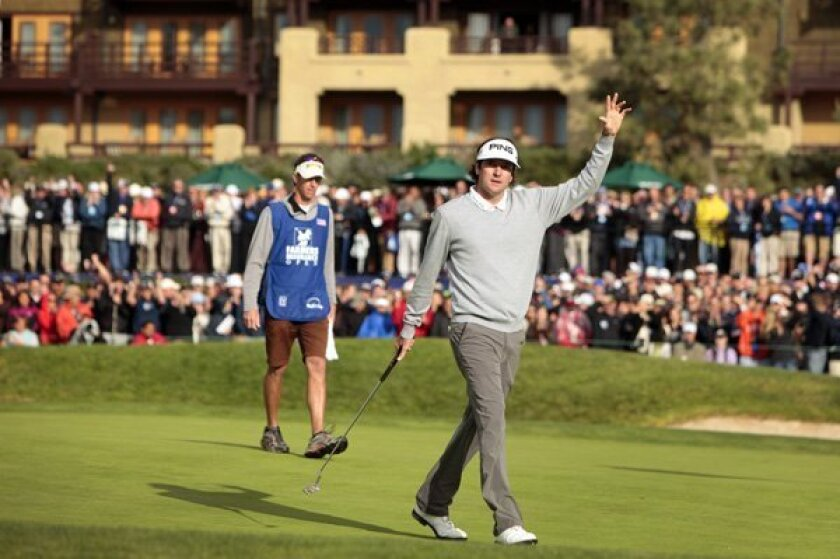 Bubba Watson celebrates on the 18th hole after making a birdie putt at the 2011 Farmers Insurance Open.