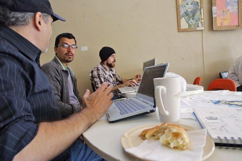 Adam Jacobs (from left), Matt Spangler and Kyle Tyacke met at Cream in University Heights to work on their Web site, Freakatars.com, over coffee. (Eduardo Contreras / Union-Tribune)