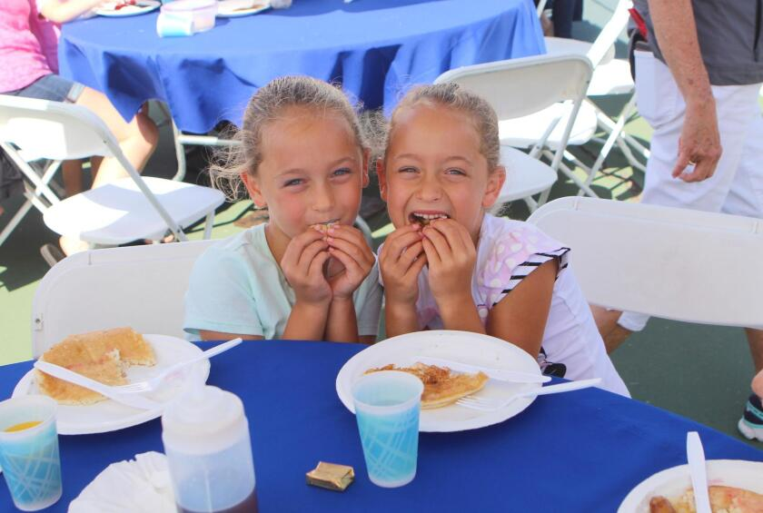 Identical twins Brooklyn and Sidney Sacks Rhys, 7, both attend the Gillispie School and love pancakes.