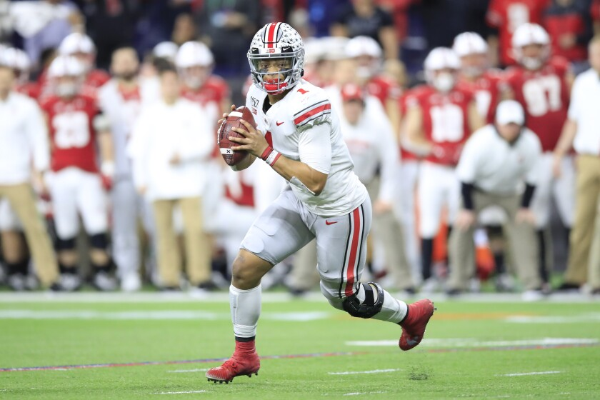 Ohio State quarterback Justin Fields looks to pass in his team's 34-21 win in the Big Ten title game Dec. 7, 2019.