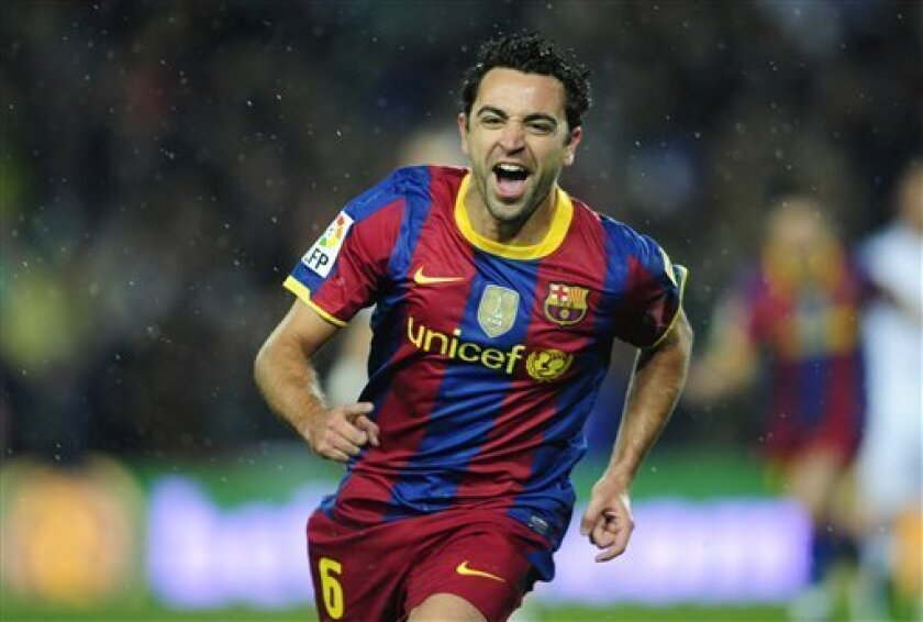 FILE-- In this Monday, Nov. 29, 2010 file photo, FC Barcelona's Xavi Hernandez reacts after scoring against Real Madrid, during a Spanish La Liga soccer match at the Camp Nou stadium in Barcelona, Spain. Xavi Hernandez, Andres Iniesta or Lionel Messi will win FIFA's Ballon d'Or trophy as the world's best player on Monday Jan. 10, 2011, and much of the teammates' success can be attributed to Barcelona's La Masia youth academy. (AP Photo/Manu Fernandez, File)