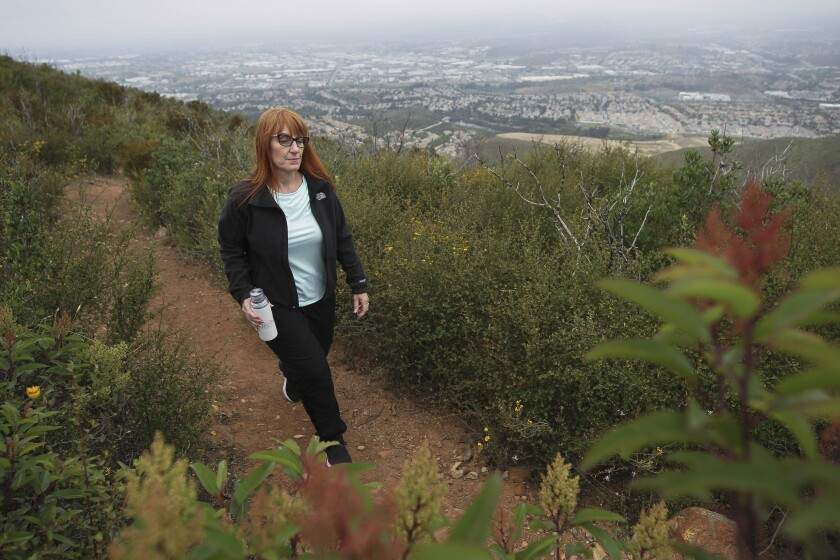 Hiker Rachel Arbuckle on a trail on Double Peak in San Marcos. Her goal: to be healthy enough to donate a kidney to her ailing father.