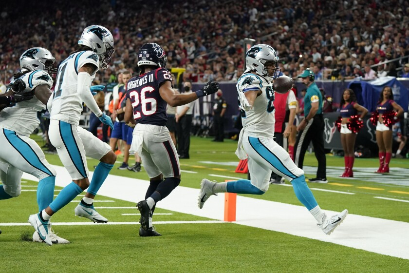 Carolina Panthers tight end Tommy Tremble (82) rushes for a touchdown as Houston Texans cornerback Vernon Hargreaves III (26) defends during the second half of an NFL football game Thursday, Sept. 23, 2021, in Houston. (AP Photo/Eric Christian Smith)