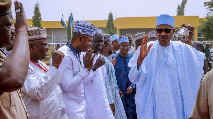 In this photo released by the Nigeria State House, Nigeria's incumbent President Muhammadu Buhari, o