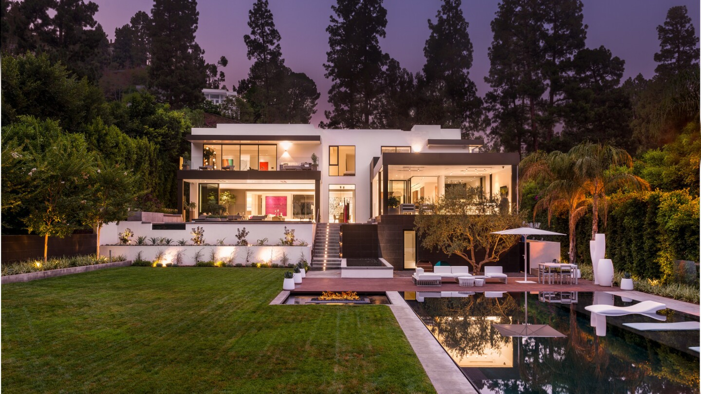 A custom wine cellar and a state-of-the-art home theater are among the features of the newly built home in Beverly Hills.