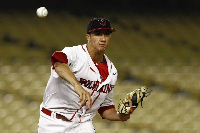 Harvard-Westlake pitcher Jack Flaherty throws to first base during the Southern Section Division 1 championship game in 2013.