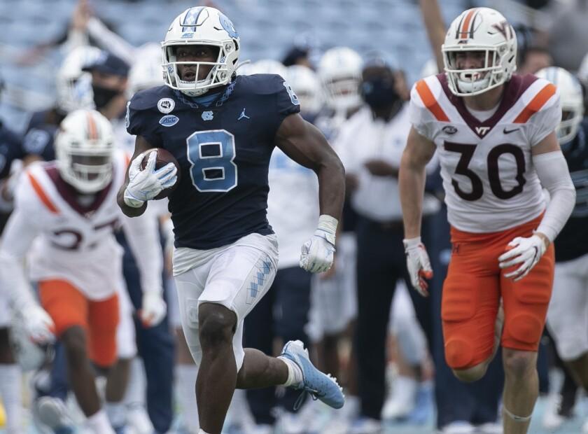 North Carolina's Michael Carter breaks away from the Virginia Tech defense for a 62-yard touchdown run.