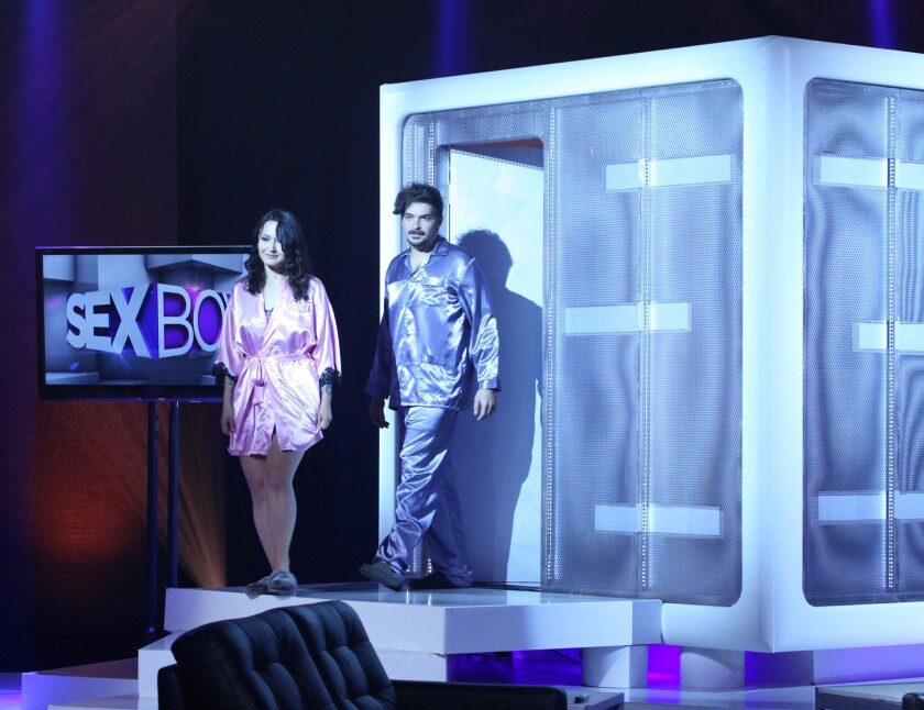 """Contestants Elle, left, and Brandon exit the """"Sex Box"""" during a taping of the new relationship therapy series on We tv."""