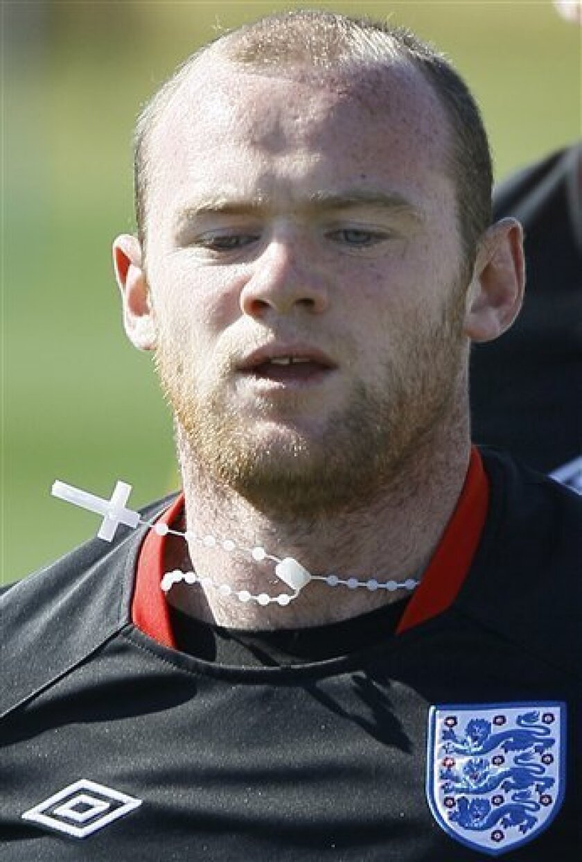 England soccer player Wayne Rooney wears a crucifix during a team training session in Rustenburg, South Africa, Tuesday June 8, 2010. England are preparing for the upcoming soccer World Cup, where they will play in Group C. (AP Photo/Kirsty Wigglesworth)