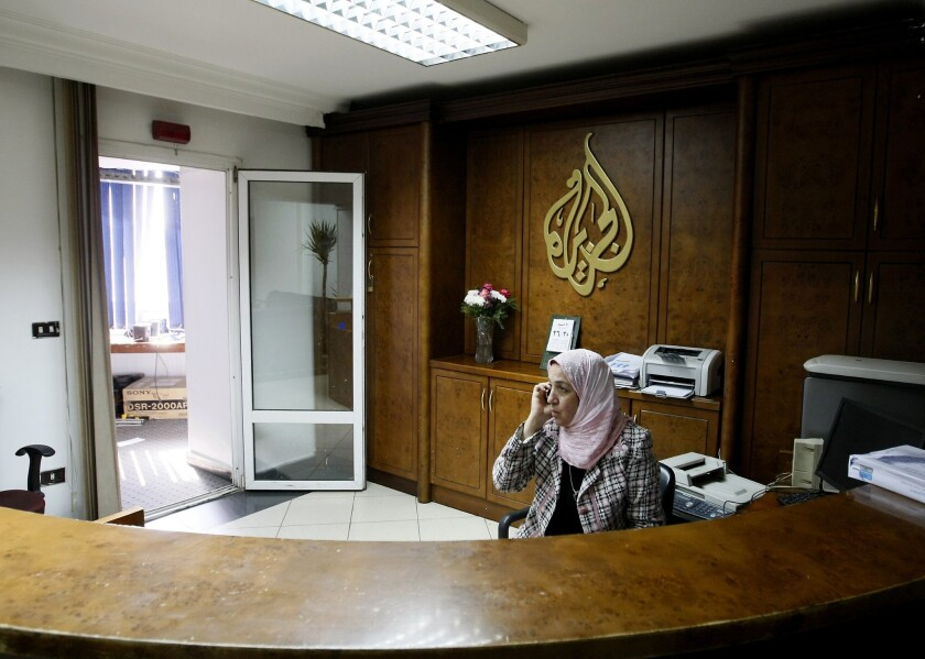 An employee of Al Jazeera talks on the phone at the television channel's now-closed bureau in Cairo.