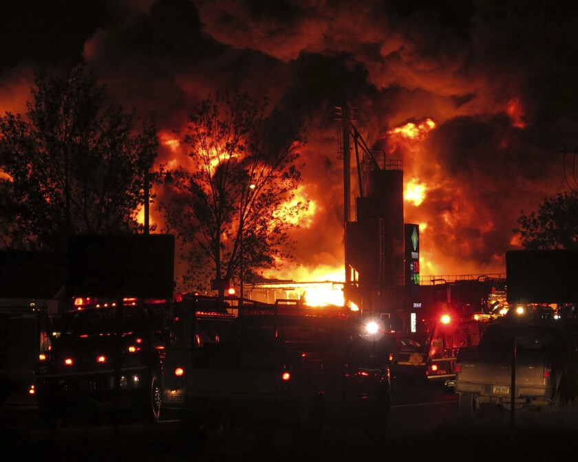 Emergency vehicles respond to a fire at Red River Supply, an oil supply company, in Williston, N.D., early Tuesday.