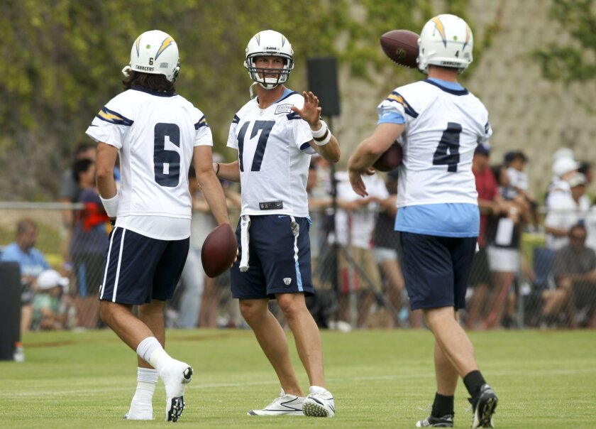 Chargers' quarterbacks, from left, Charlie Whitehurst, Philip Rivers, and Brad Sorensen, during Chargers training camp at Chargers Park in San Diego on Friday.