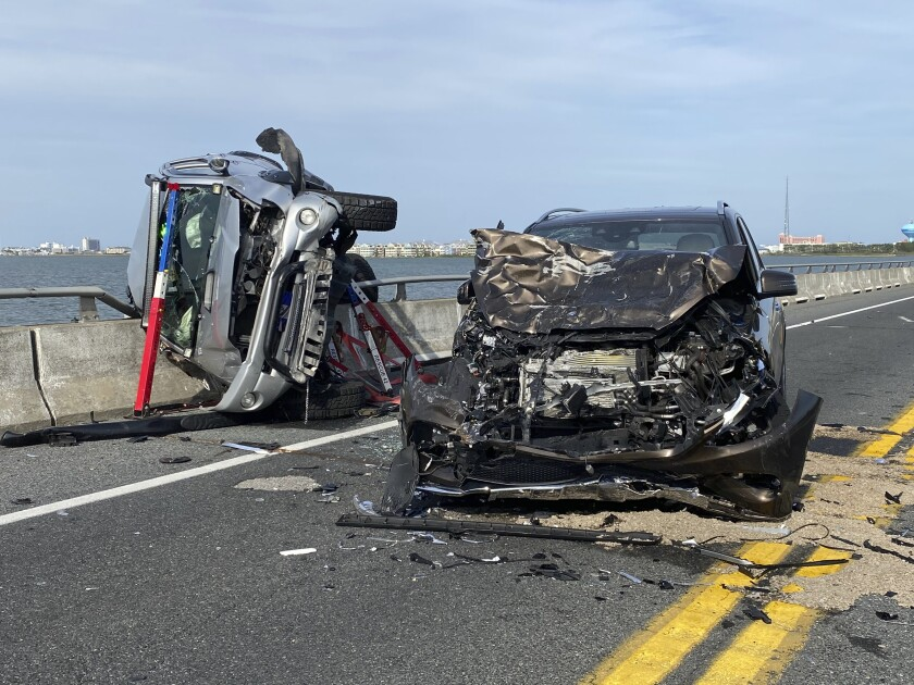 This photo provided by the Ocean City Fire Department shows the wreckage from a car accident on the Route 90 bridge in Ocean City, Md., on Sunday, May 2, 2021. A bystander jumped over a highway guard rail and into a Maryland bay Sunday to rescue a child who had been thrown from a car and into the water during the crash, according to authorities. The child was ejected from a car on the Route 90 bridge in Ocean City and landed in the Assawoman Bay, the Ocean City Fire Department said in a statement. At least eight people were injured in total, the agency said. (Ocean City Fire Department via AP)