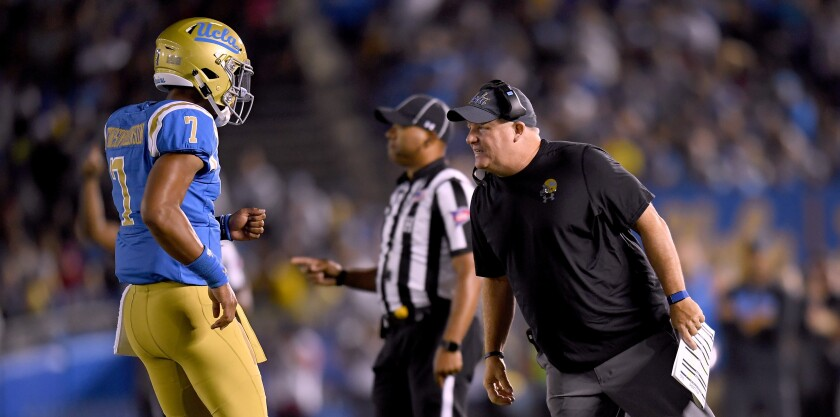 UCLA coach Chip Kelly speaks with quarterback Dorian Thompson-Robinson during a game against Fresno State last year.