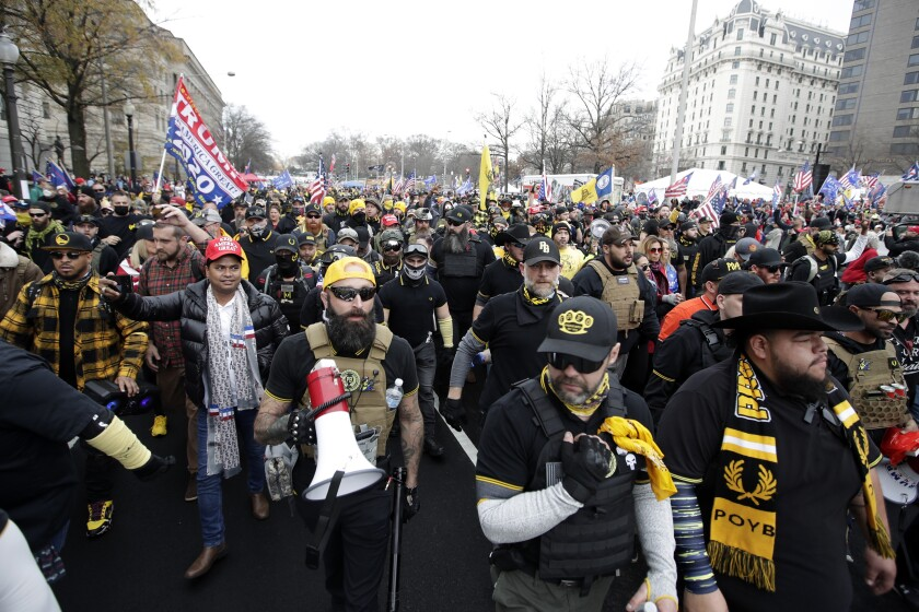 Supporters of President Trump wear clothing associated with the Proud Boys at a Dec. 12 rally in Washington, D.C.