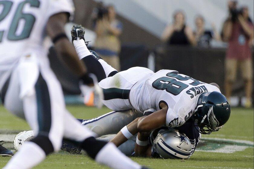 Philadelphia Eagles' Jordan Hicks (58) tackles Dallas Cowboys' Tony Romo (9) after a fumble during the second half of an NFL football game, Sunday, Sept. 20, 2015, in Philadelphia. (AP Photo/Matt Rourke)