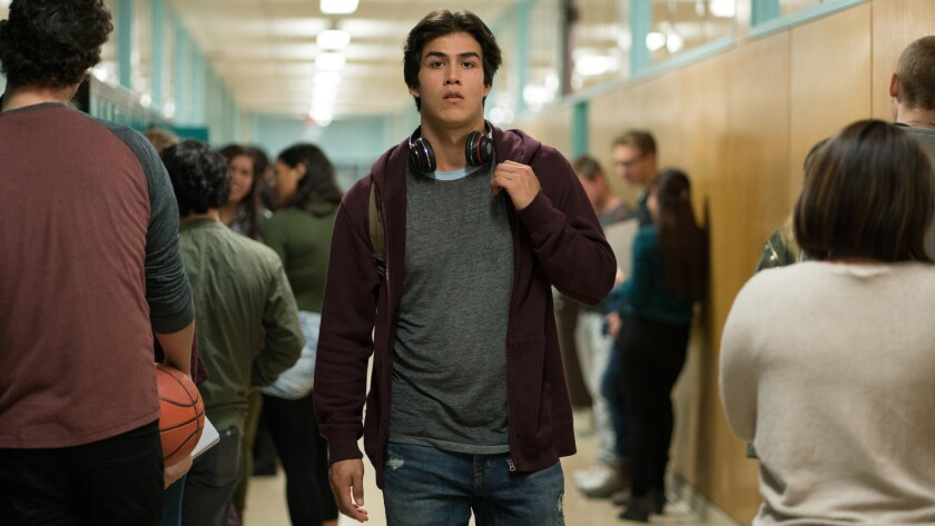 "Joel Oulette walks down a school hallway in ""Trickster."""
