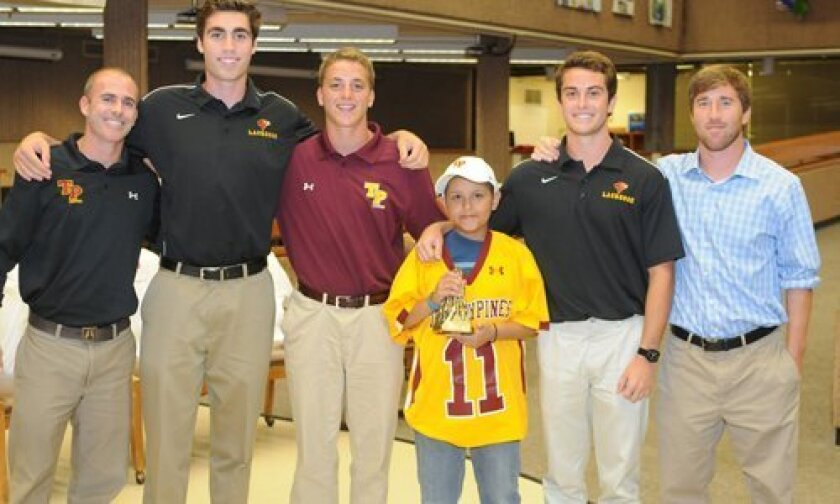 Jose Montano with coaches and team captains. Photo/McKenzie Images
