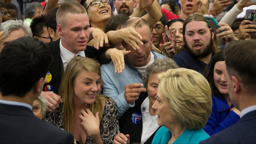 Supporters reach toward Hillary Clinton on Tuesday after her speech at UC Riverside.
