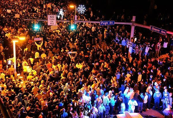 Penn State students pour into the streets of downtown State College, Pa., on Wednesday night after the university's Board of Trustees fired football coach Joe Paterno and the school's president, Graham Spanier.